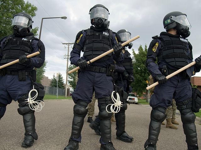 Officers in Riot Gear with Hardwood Riot Baton